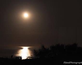 Hazy Moon Over The Ocean