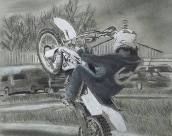 Charcoal drawing of a wheelie on a dirtbiker
