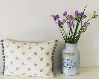 Oblong bee cushion with grey linen back with Pom Poms