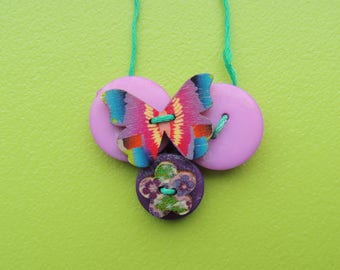 Purple butterfly necklace made with buttons