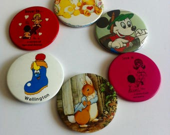 Vintage 1980's large badges, care bears, Love is, Mickey mouse, peter rabbit, Wellington.
