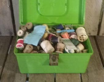 Vintage Sewing Box Filled With Thread And Empty Wooden Spools