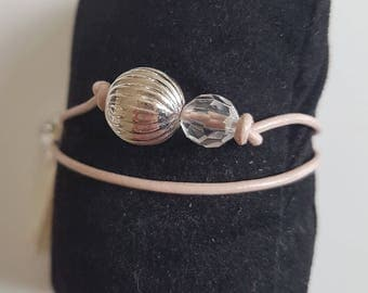 leather strap and beige colored beads and rose