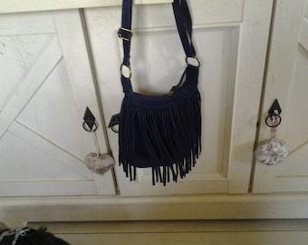Bag has shoulder strap suede travel