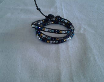 Wrap bracelet in gold, black, white Crystal and genuine stones
