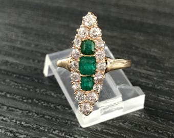 Emerald and diamond antique navette ring in 14k yellow gold