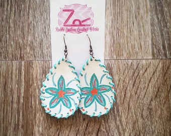 Whipstitched drop earrings with a handpainted flower