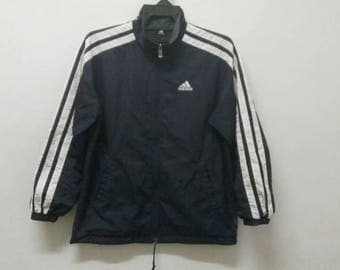 Vintage Adidas windbreaker jacket with three stripe large size L
