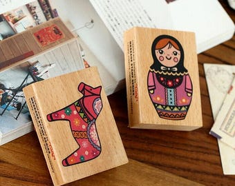 Wooden and rubber stamps and Russian doll