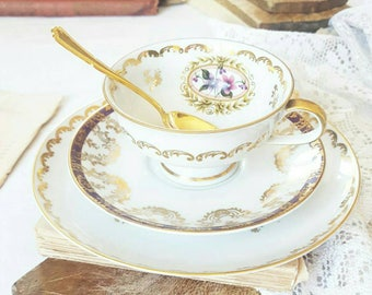 Cup, saucer, plate dessert and spoon set