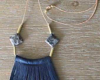 Double diamond fringe in navy leather