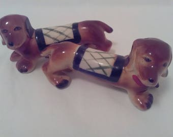 So cute! Vintage daschaund salt and pepper shakers -hand painted with corks