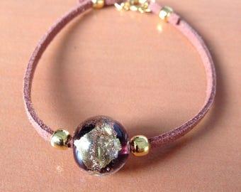 Pearl bracelet on camel suede