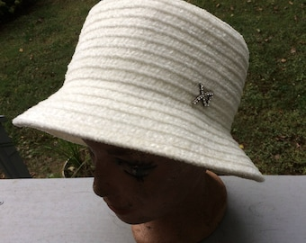 Women's white cloche hat with pin