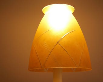 A vintage opaque etched glass light shade.