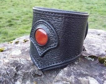 Black leather with a cornelian set bracelet