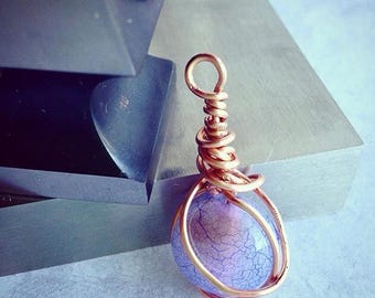 Copper wire pendant.