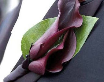 Real feel calla lily corsage.