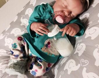 "Reborn GLASS faux milk Bottle featuring a ""NO HOLE"" nipple."