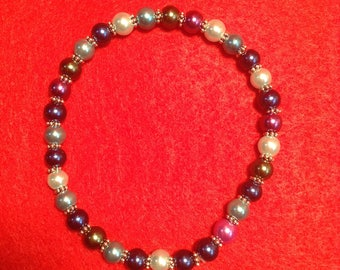 Elastic bracelet, glass beads and metal spacers