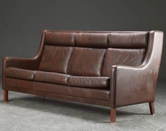 Danish high back three seater leather sofa