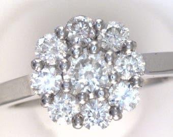 Round Cut Diamond Cluster Set Ring. In 100% Palladium.