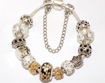 """""""Pandora"""" style Bracelet with silver and gold charms"""