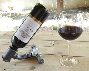 Display wine bottle in plumbing fittings