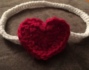 Crocheted headband with heart. Optional elastic for cochlear implants.