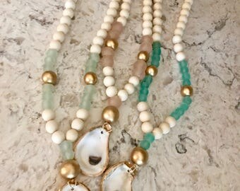 Recycled glass bead necklaces with oysyers