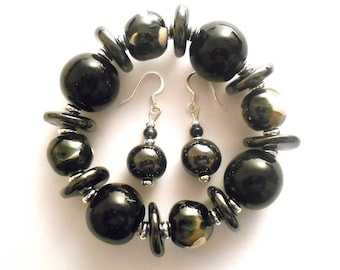 Kazuri ceramic fair trade bracelet in black with black and white abstract beads.
