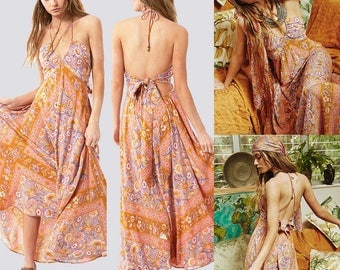 A Bohemian floral print dress with a plunging back and a back swing dress