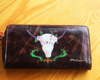 Hand painted leather wallet.