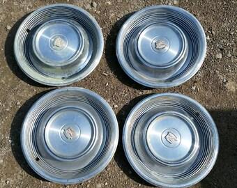 "4 Cadillac 1968 - 69, 15"" wheel covers/hub caps."