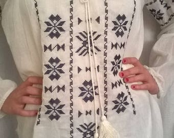 White embroidered cotton long sleeve blouse
