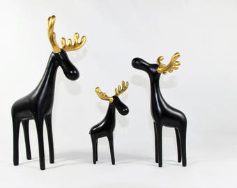 Family of Three Black Reindeer Sculptures with Golden Antlers