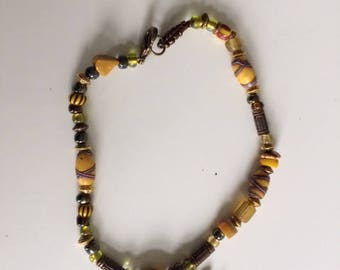 Multi coloured Boho-chic bracelet handmade with trade beads. For festivals and summer wear.