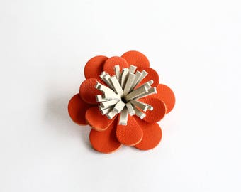 Barrette / clip in bright orange leather