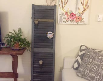 Black decor shutter with a hint of gold