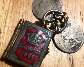 A vintage charm or pendant made using a 1902  royal coronation Edward VII commemorative miniature photo album & two silver coins