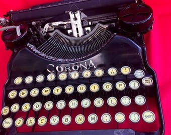 Vintage Black Typewriter by Corona Four with a Carrying Case