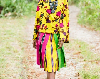 GRIZEL CAPE TOP  This floral print top's cape overlay sways with each step