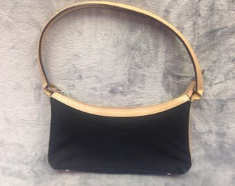 Beige and black canvas bag with leather effect top panel and strap