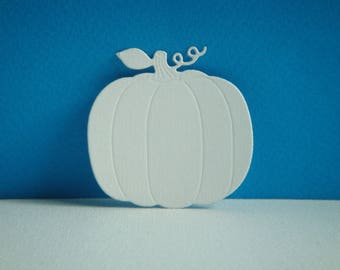 Cut out pumpkin to create white drawing paper