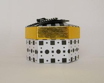 Black, white and gold origami hexagonal box