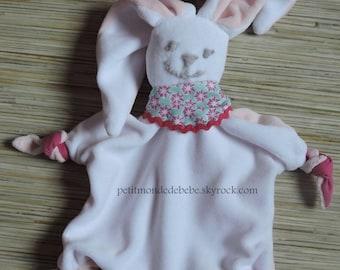 Plush white rabbit and pink handkerchief
