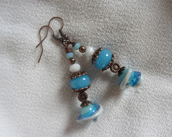 Dangling artisan Lampwork, Puck and flower on stem, blue and white and copper metal charm