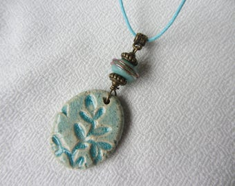 Oval Pendant Necklace ceramic embossed leaf pattern and glass bead yarn blue Mint, brass and blue cotton cord