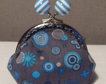 Turquoise wallet with clasp decorated with striped balls.