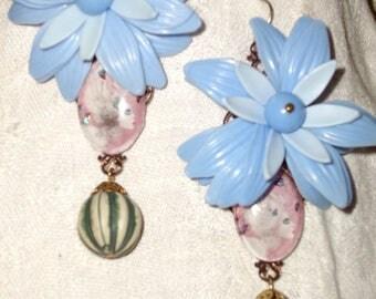 Vintage earrings fascinating woman with butterflies